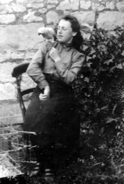 Girl In Garden With Parrot On Shoulder c.1910