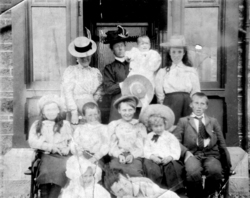 Group Of Edwardian Children Sitting By Porch c.1910