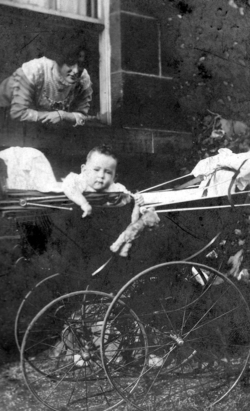Woman Leaning Out Of Window, Child In Pram 1900s