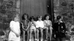 Children Sitting In Doorway c.1937