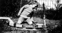 Young Boy Playing With Model Train Set In The Garden c.1932