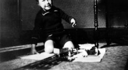 Young Boy Playing With Model Train Set c.1932