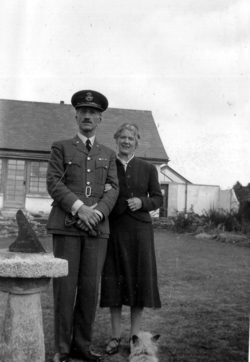 Couple Standing By Sundial In The Garden c.1940