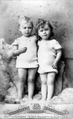 Studio Portrait Twin Sisters Standing On Sheepskins c.1892