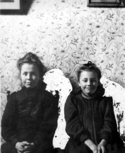 Two Edwardian Girls Seated On Chairs c.1910