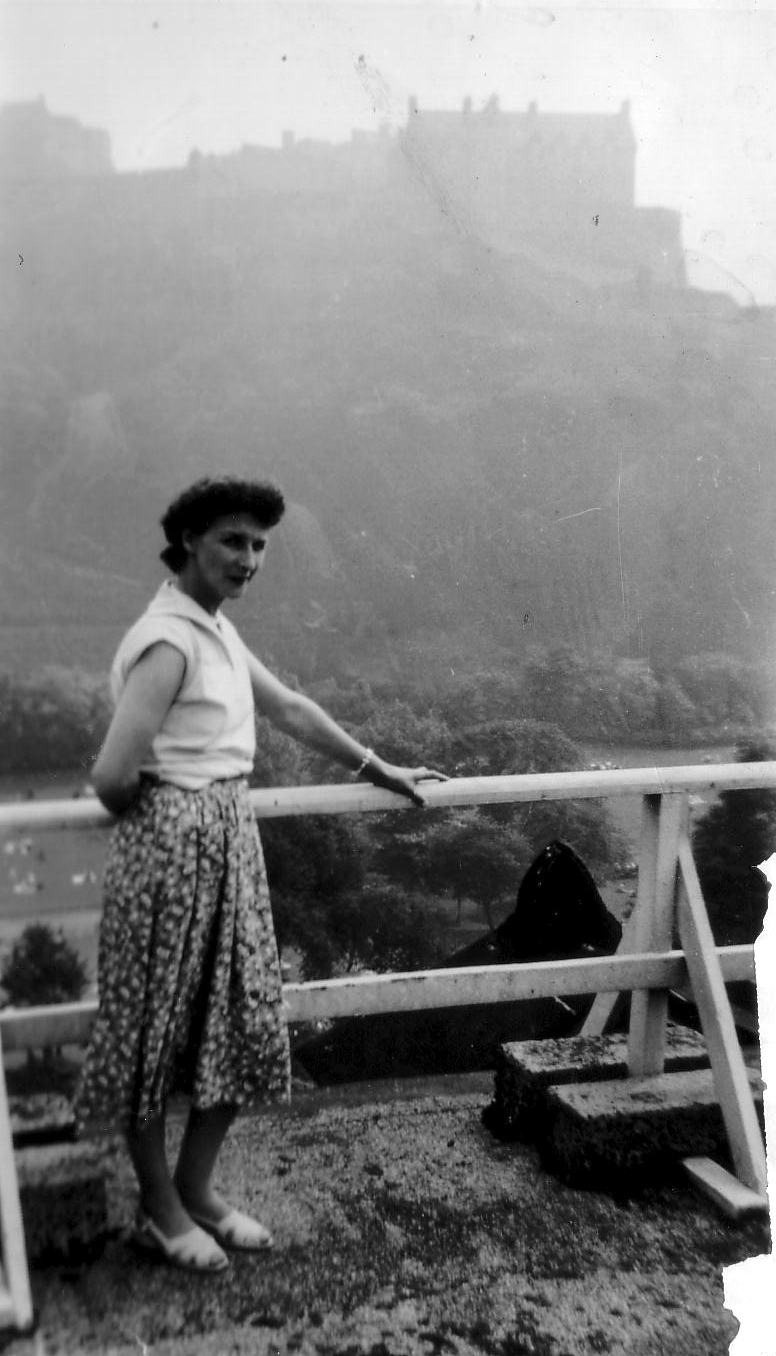 Woman Standing In Front Of Princes Street Gardens Castle Rock In Background, early 1960s
