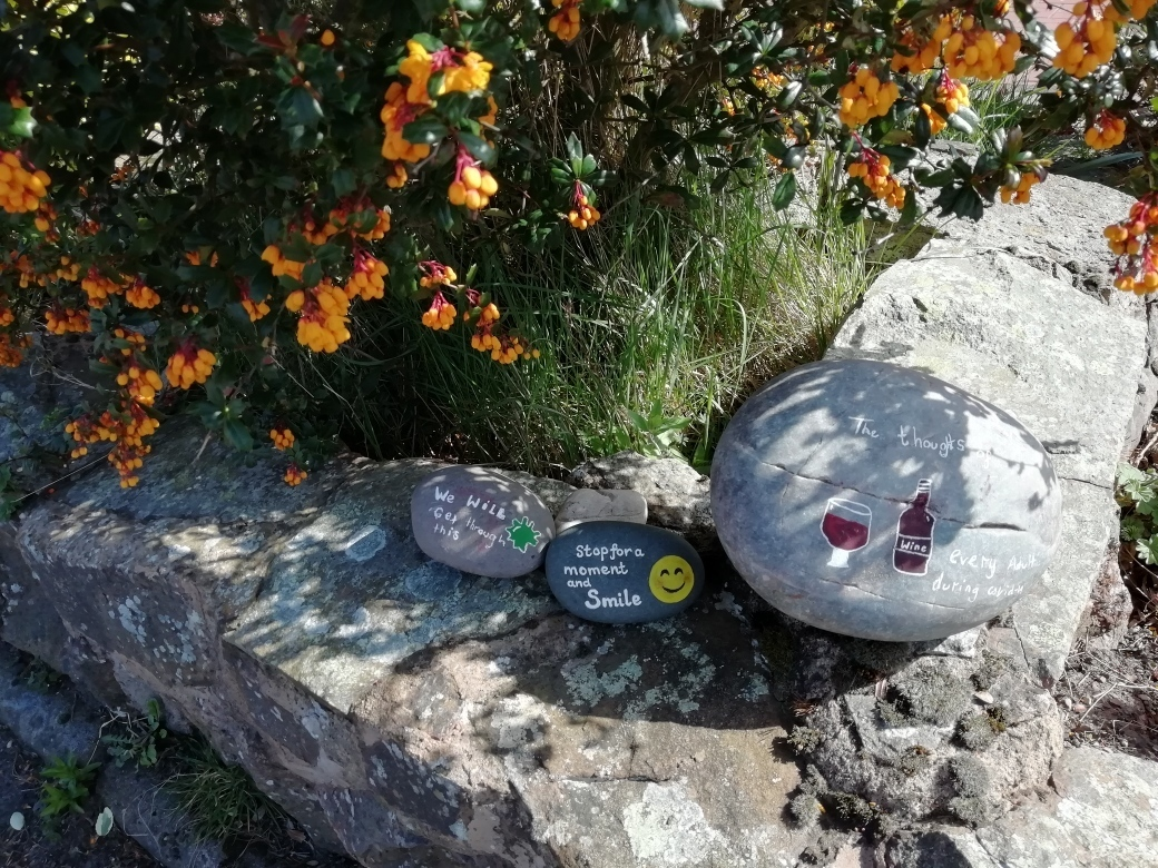 Stones painted with positive messages