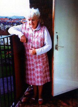 Elderly Woman Standing On The Balcony Of Her Home At Restalrig House c.2010