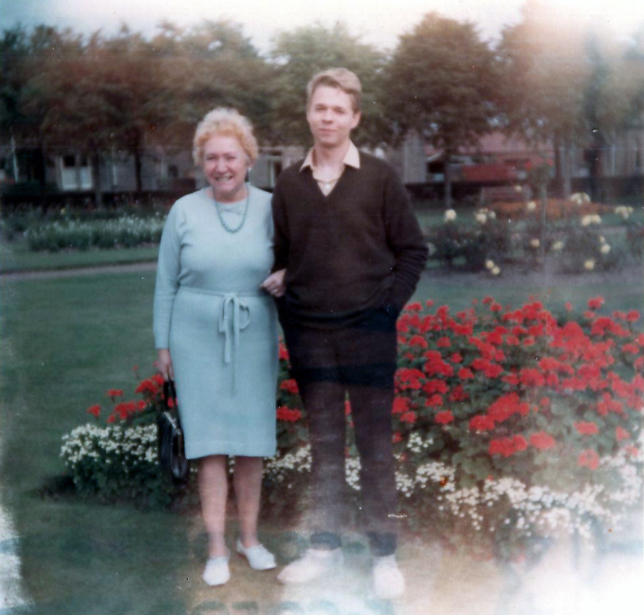 Mother And Son Standing By Flower Bed In Park c.1968