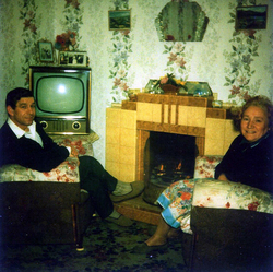 Couple Sitting Round The Living Room Fire c.1962