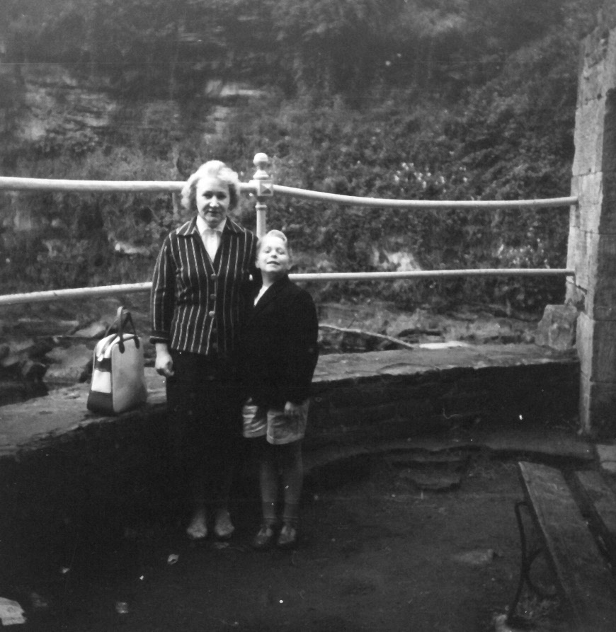 Mother And Son Standing On Viewing Point By River c.1960
