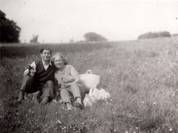 Couple Having Picnic In Meadow 1970s