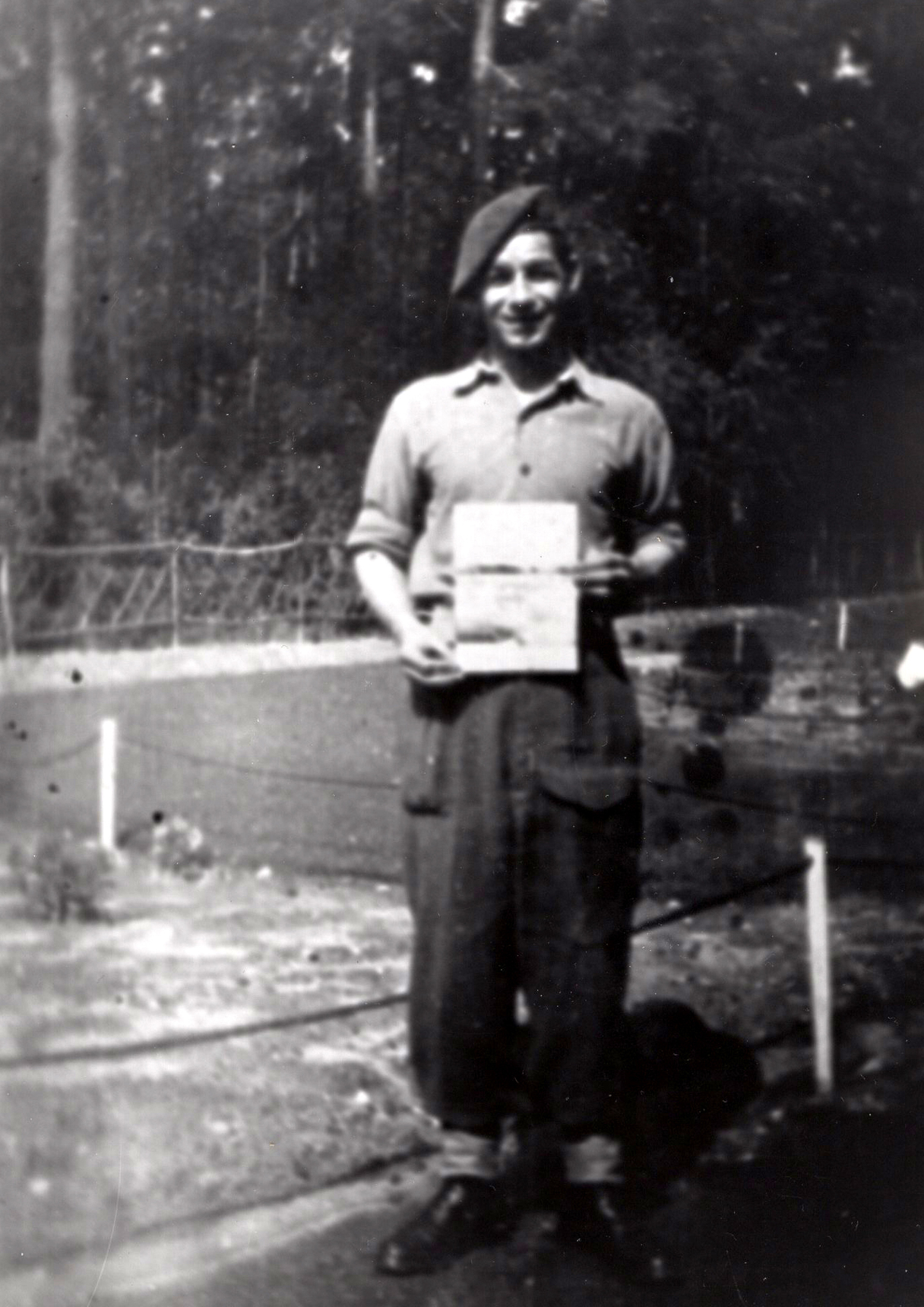 RAF Regiment Serviceman Holding Up Document, 8th Sept 1948