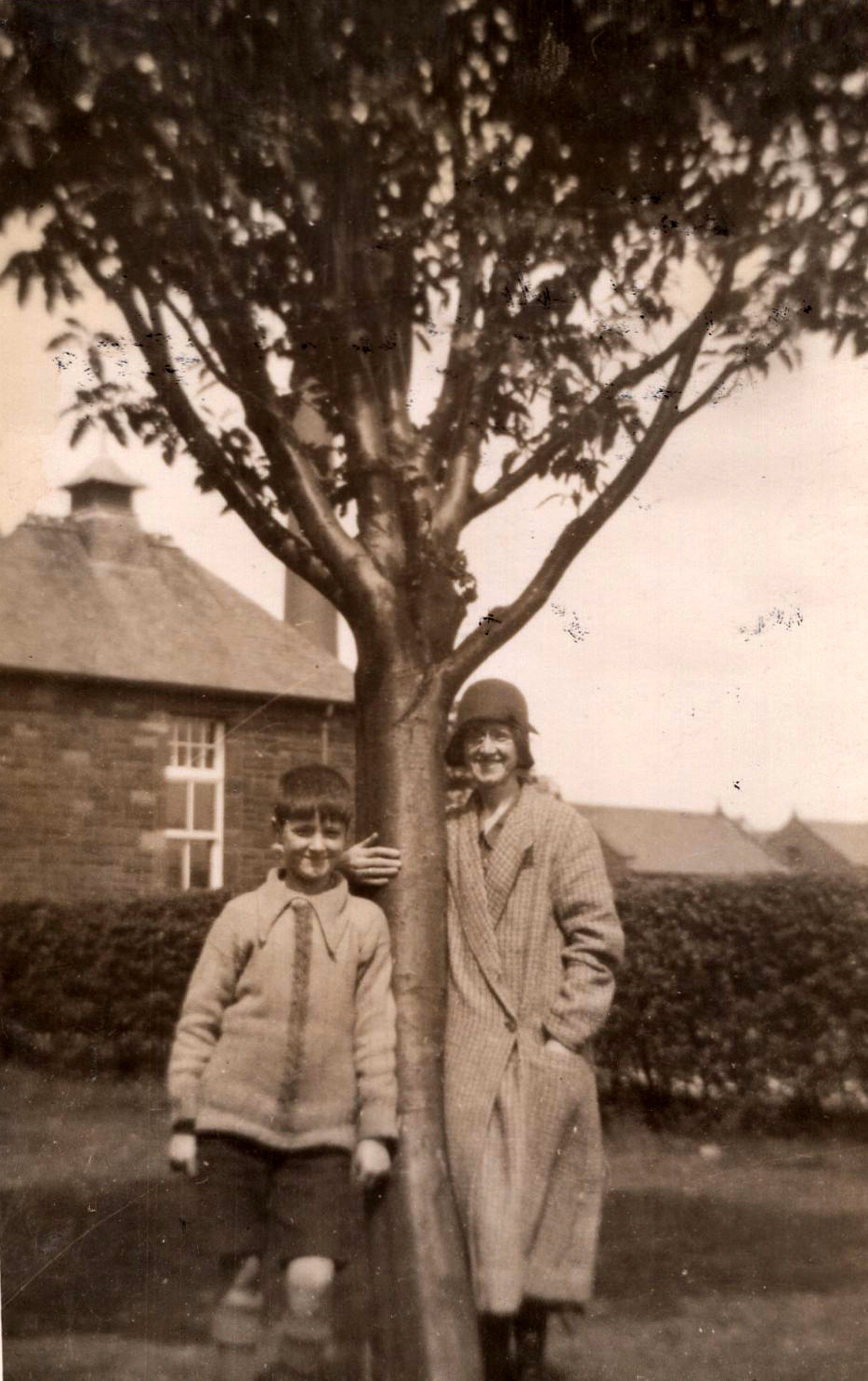 Woman And Boy Standing By Tree c.1930