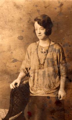Studio Portrait Woman Leaning On Chair c.1928