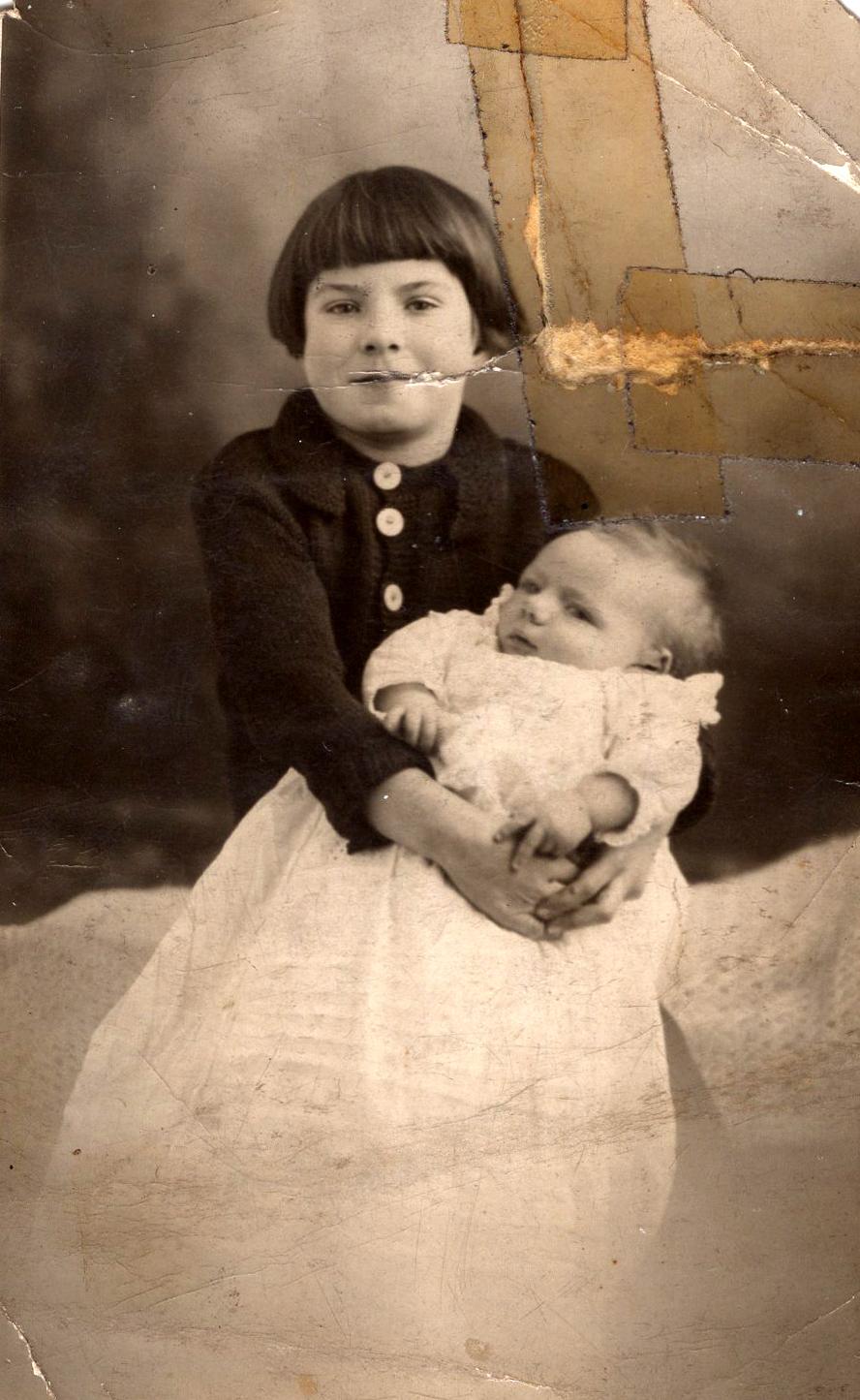 Studio Portrait Girl Holding Baby, 15th February 1933