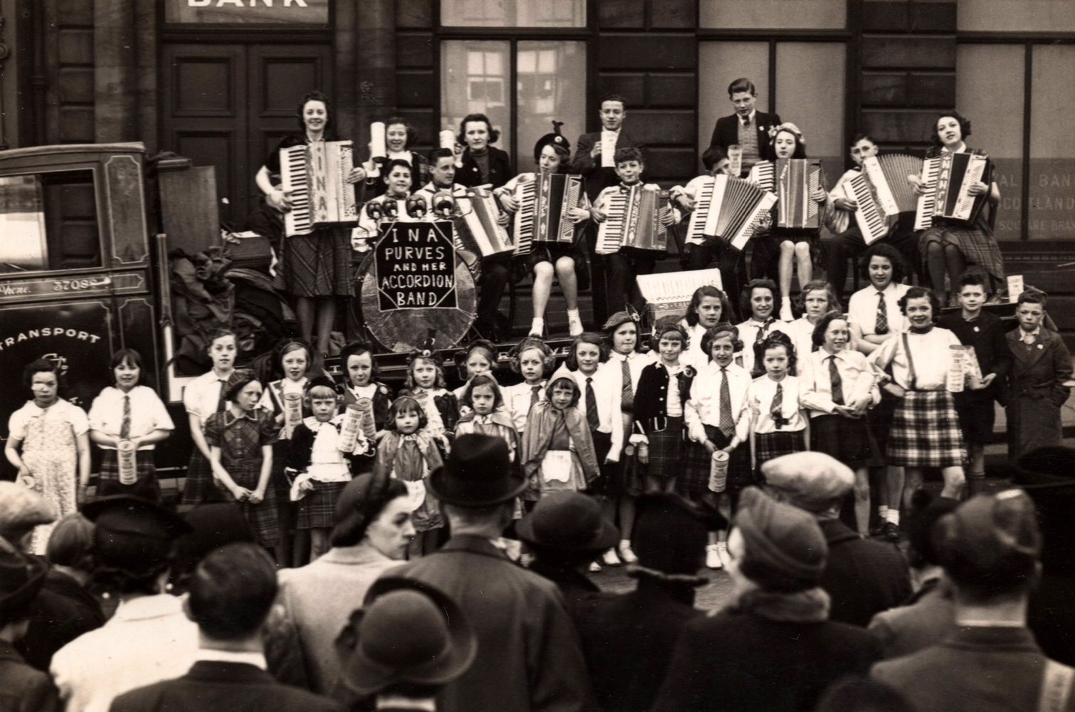 Ina Purves And Her Accordion Band On Float Outside Branch Of Royal Bank Of Scotland c.1940