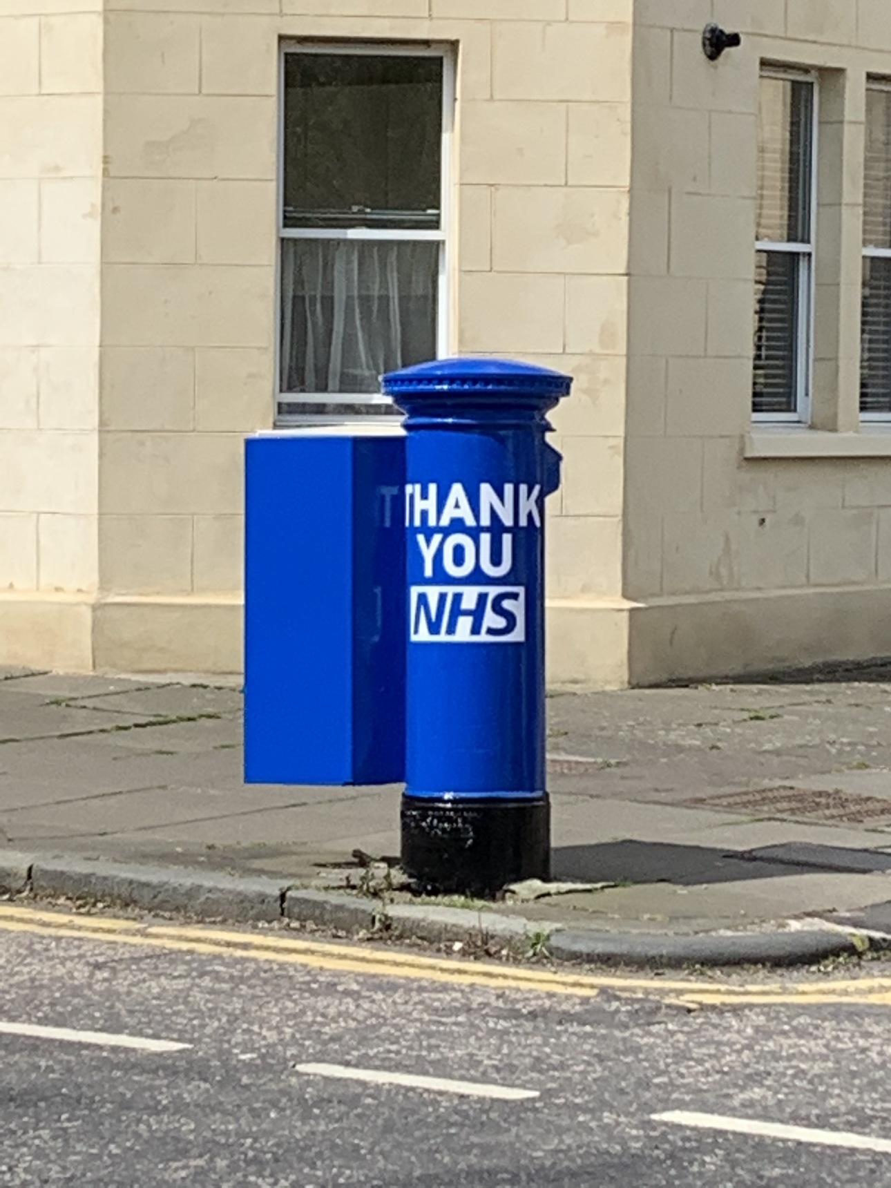 Post box painted blue with Thank You NHS
